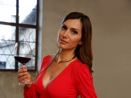 Lady with a glass of Pinot Noir