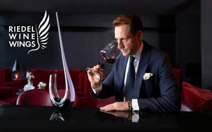Maximilian Riedel enjoys red wine out of a RIEDEL Winewings glass 1234/0