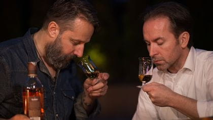 Two men smell Sommeliers Single Malt Whisky glasses
