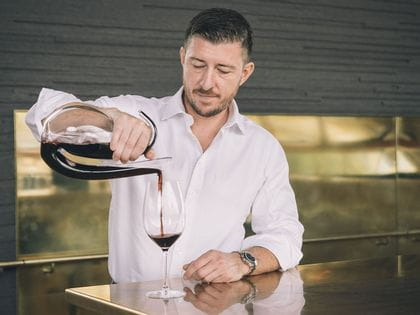 Mark Baulderstone pouring red wine with Ayam Decanter slightly off centre