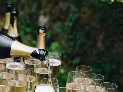 Pexels image: pouring champagne into many glasses